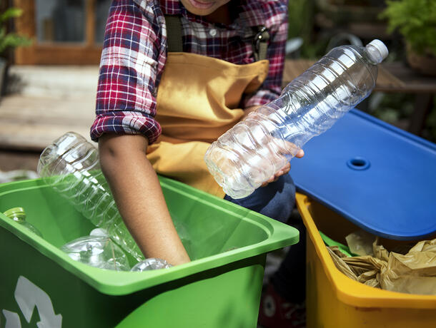 Interwaste - image of a young person sorting plastic waste for recycling